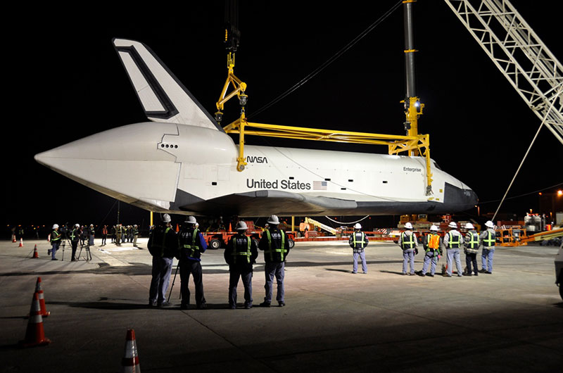 Space shuttle Enterprise hoisted off jumbo jet in New York