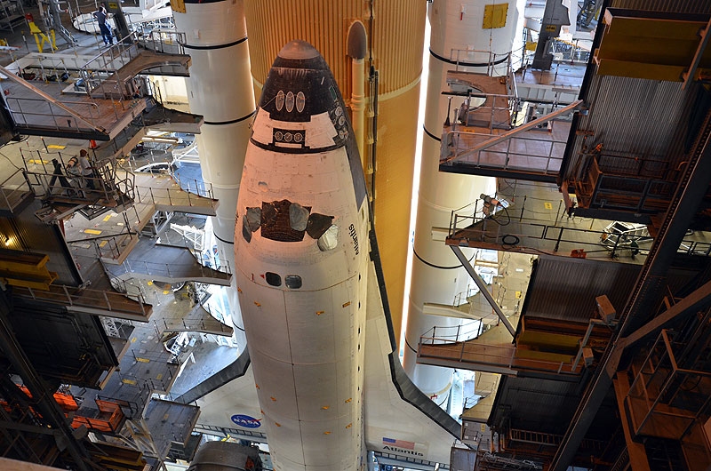 Final shuttle rolls out to launch pad as next-to-last lands
