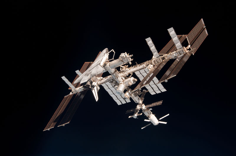 Space station, shuttle pictured in historic photos