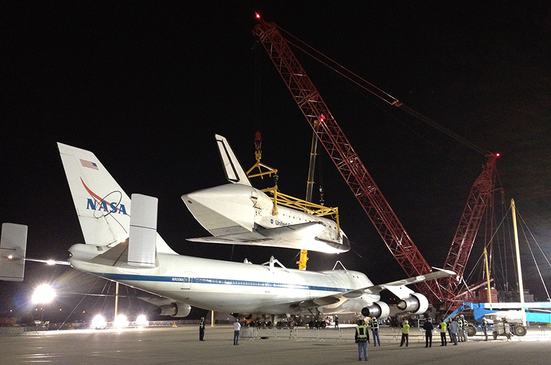 Shuttle Endeavour hoisted off jet for road trip to L.A. museum
