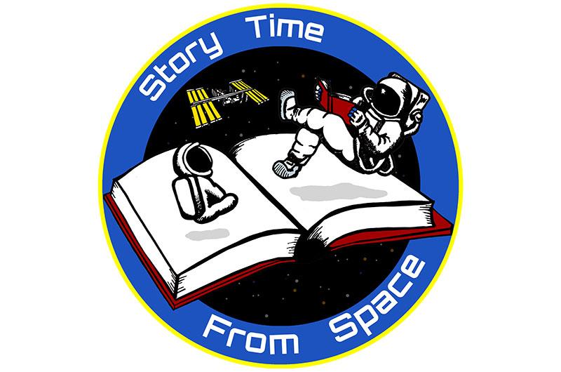 astronaut reading book - photo #7