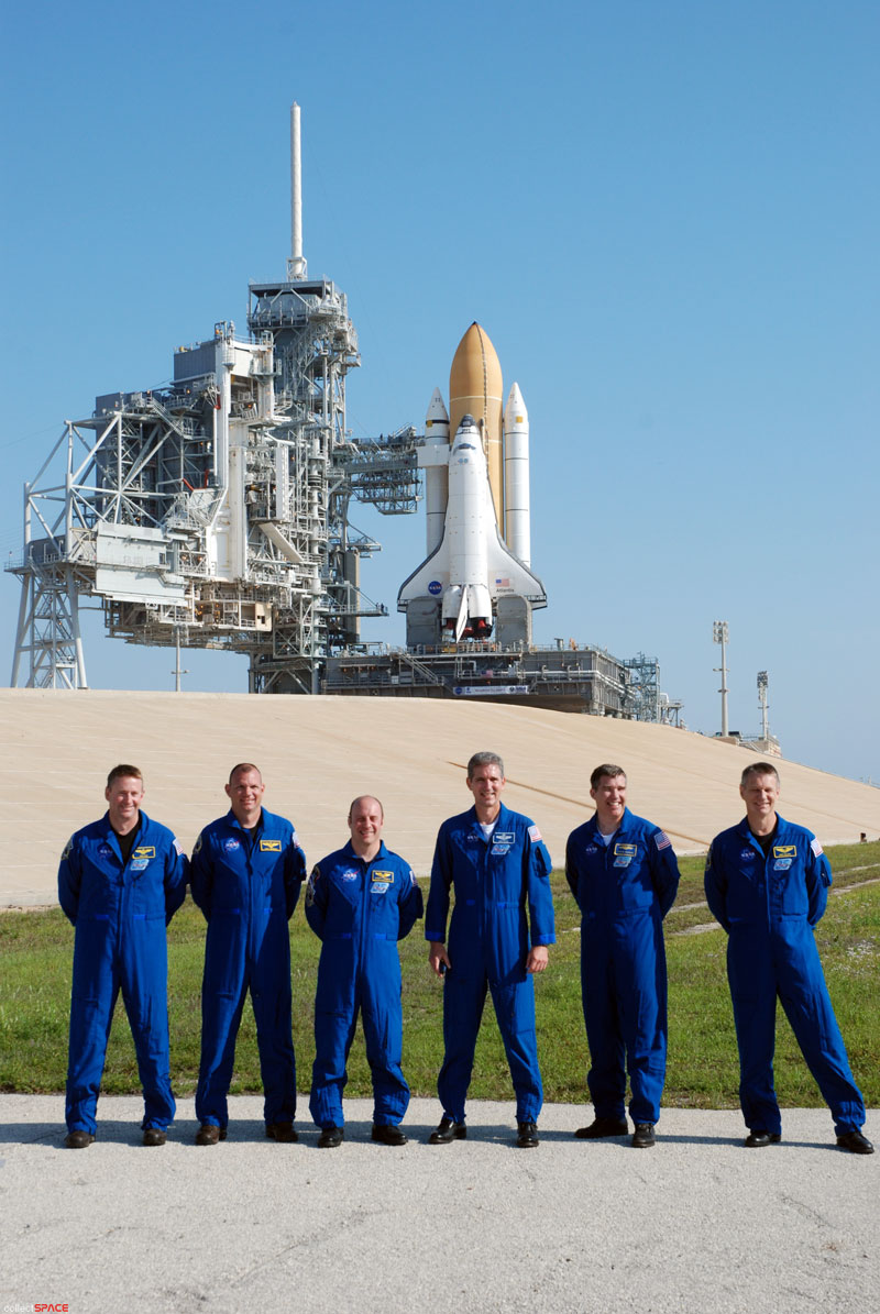 Atlantis and astronauts at the pad
