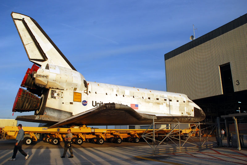 Space shuttle Discovery departs hangar for final flight