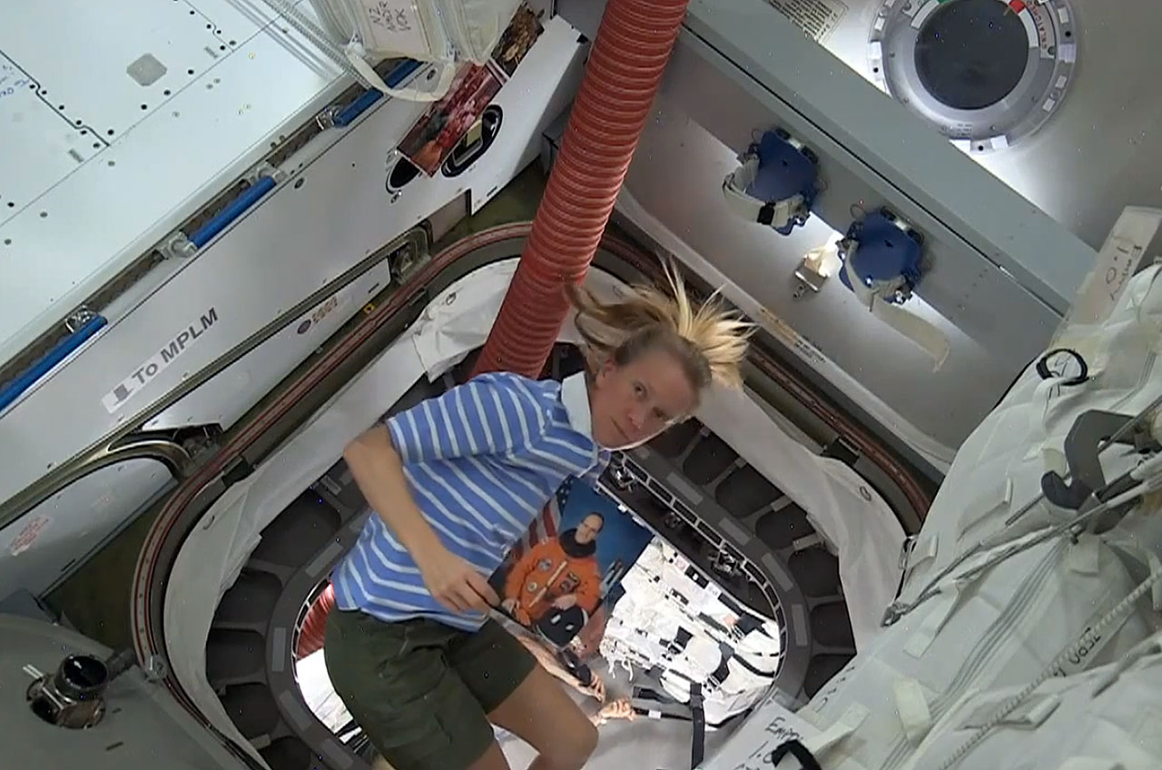 NASA Astronaut Karen Nyberg Floats Out Of Orbitals First Cygnus Cargo Craft With A Photo The Late G David Low Namesake For Spaceship On