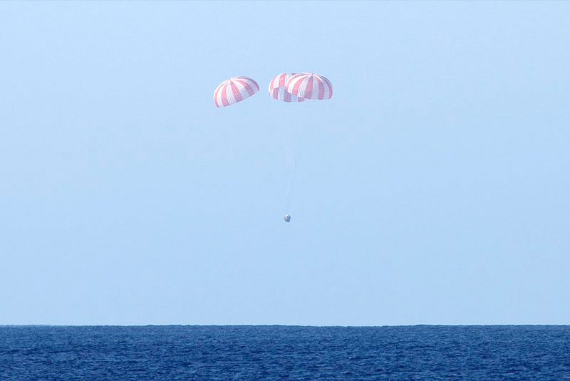 To orbit and back: SpaceX makes history with Dragon
